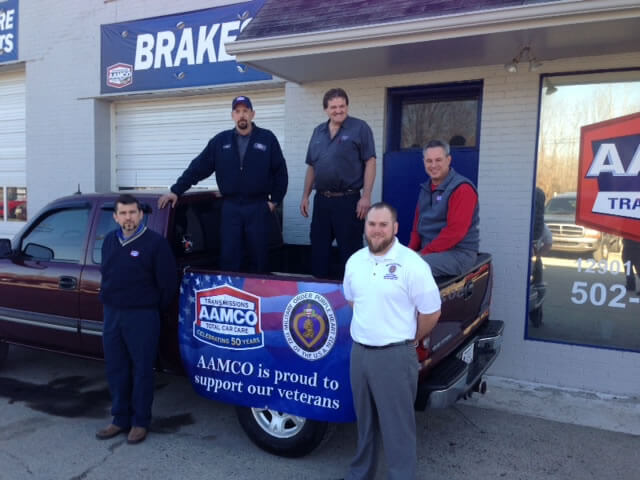 AAMCO Louisville KY owner John Summers veteran Travis Tiffany and repair team
